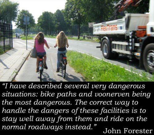 "Photo of two girls cycling safely on cycle path away from the busy road, with John Forester quote: ""I have described several very dangerous situations: bike paths and voonerven being the most dangerous. The correct way to handle the dangers of these facilities is to stay well away from them and ride on the normal roadways instead."""