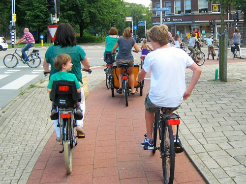 Families ride bikes on the Dutch cycle paths.