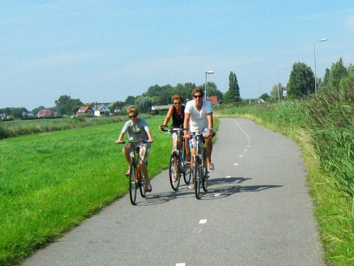 A family riding bikes in the Dutch countryside