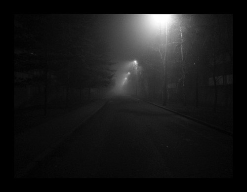 A photograph of a dark, empty, spooky street