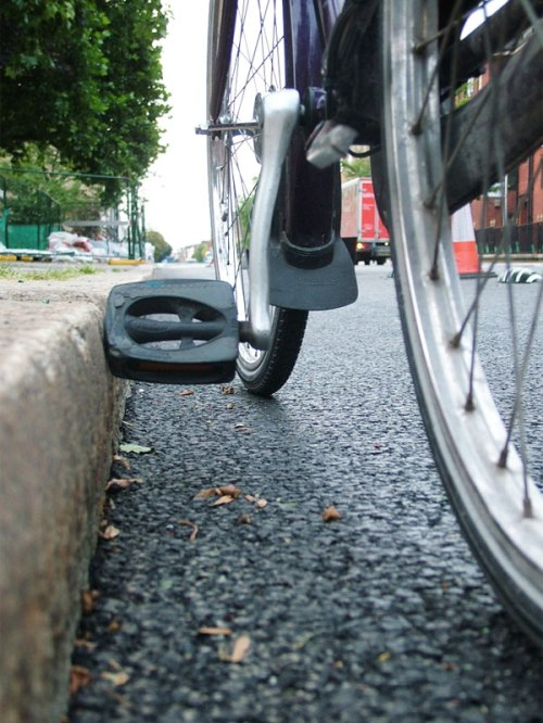 A photo of a bicycle pedal hitting the high kerb at Royal College Street.