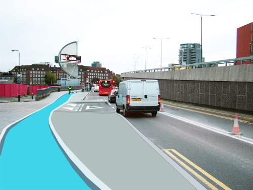 An altered photograph of Stratford High Street leading to Bow roundabout, showing how a cycle path and road junction should be done.