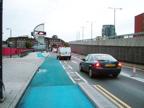 Cycle Superhighway 2 westbound, just before Bow roundabout. A dangerous side road treatment followed by a sharp bus stop bypass entry.