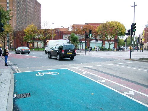 The eastern end of Cycle Superhighway 2 where users are expected to cycle onto a crossing where people are waiting.